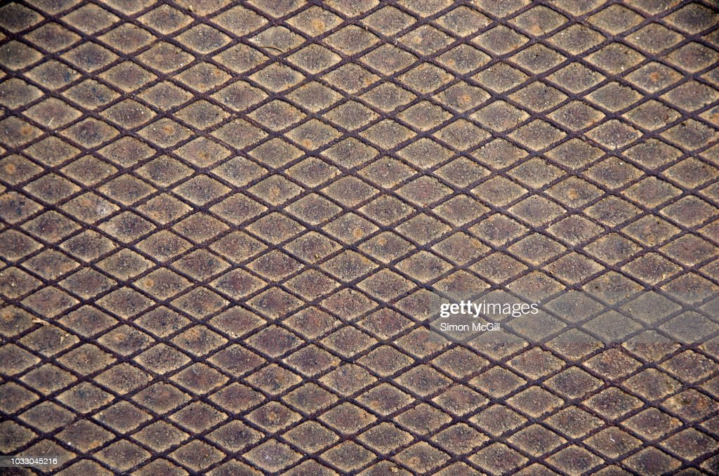 Rusted Metal Plate With A Diamond Pattern Stock Photo