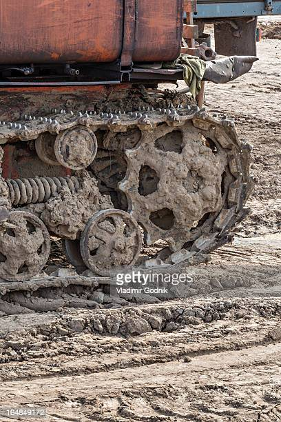 Rusted metal treads on a backhoe