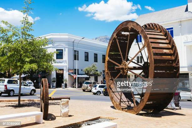A rusted old mill wheel sculpture sits on display in the Meulplein municipality of Stellenbosch South Africa on Friday Jan 26 2017 Markus Jooste...
