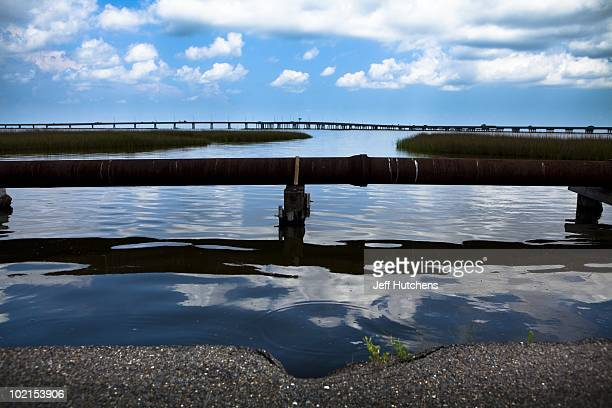 A rusted pipeline sits above the water in the area near the Deepwater Horizon disaster and the British Petroleum oil spill off the Gulf Coast on June...