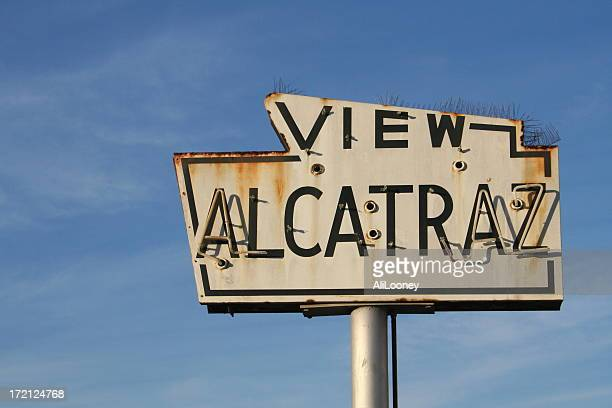 rusted view alcatraz sign with blue sky in background - alcatraz stock photos and pictures