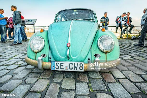 rusted vw käfer (beetle) oldtimer parked during the event with magnus walker on the fish market hamburg - beetle stock pictures, royalty-free photos & images