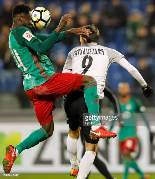 Rustem Mukhametshin of FC Tosno and Eder of FC Lokomotiv Moscow vie for a header during the Russian Football League match between FC Tosno and FC...