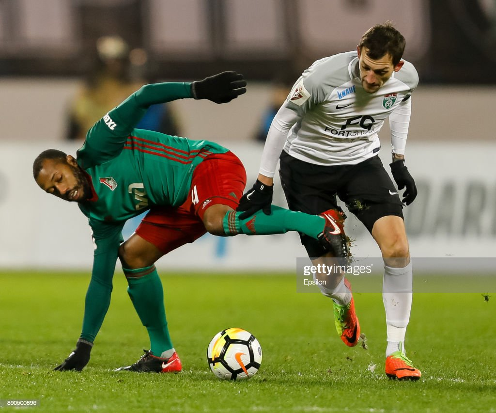 Rustem Mukhametshin (R) of FC Tosno and Manuel Fernandes of FC Lokomotiv Moscow vie for the ball during the Russian Football League match between FC Tosno and FC Lokomotiv Moscow on December 11, 2017 at Petrovsky Stadium in Saint Petersburg, Russia.