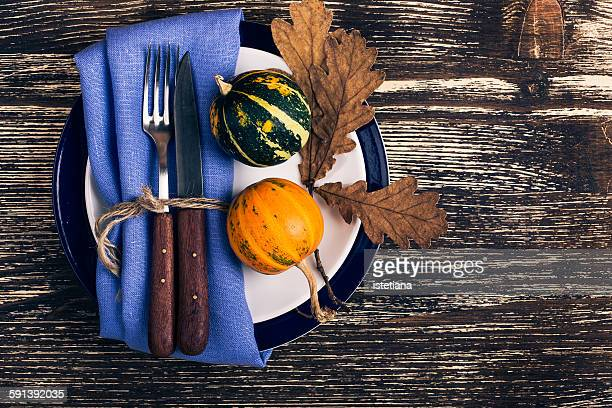rustic autumn place setting with miniature pumpkin - harvest table stock pictures, royalty-free photos & images