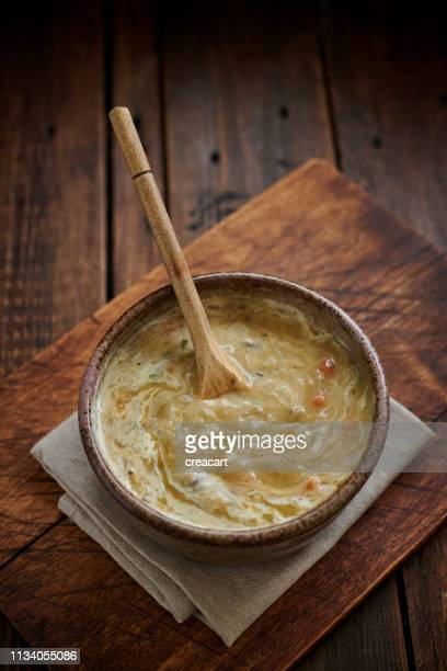 rustic bowl filled with chicken, mushroom and rice soup topped with double cream. - comfort food stock pictures, royalty-free photos & images