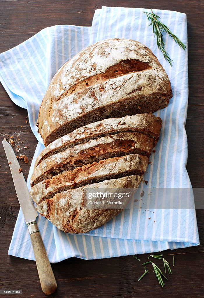 Rustic bread with knife : Stock Photo