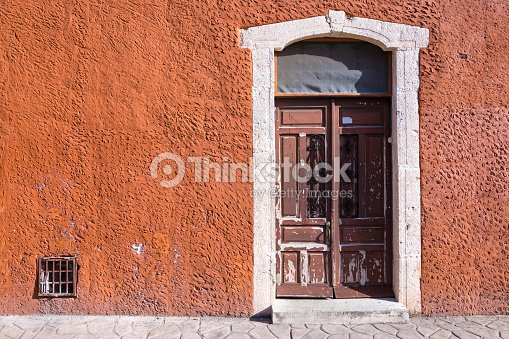 Rustic Colonial Style Entry Door Stock Photo