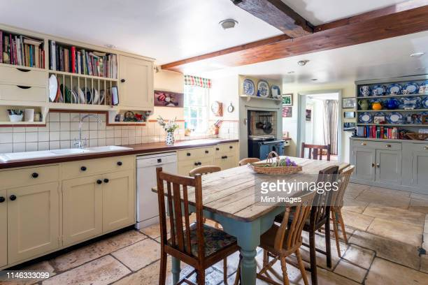 rustic domestic kitchen, country style room in a house - kitchen stock pictures, royalty-free photos & images