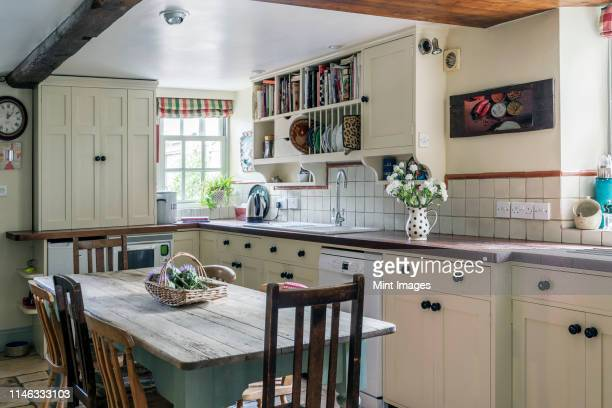 rustic domestic kitchen, country style room in a house - domestic kitchen stock pictures, royalty-free photos & images