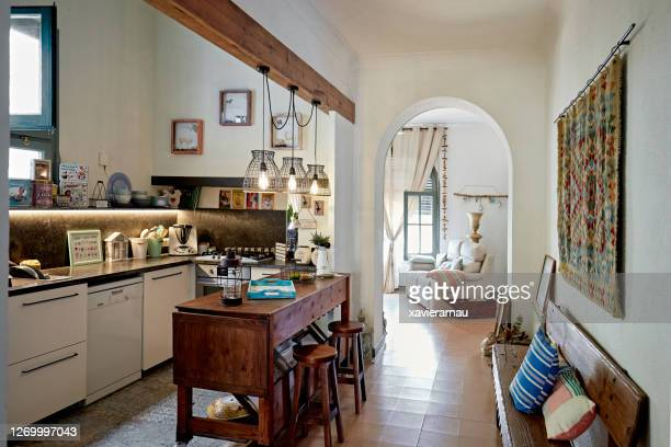 rustic domestic kitchen in spanish home - two seater sofa stock pictures, royalty-free photos & images