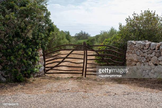 a rustic door that gives access to an agrarian property. - pueblo built structure stock pictures, royalty-free photos & images