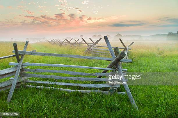 rustic fence in field - gettysburg stock photos and pictures