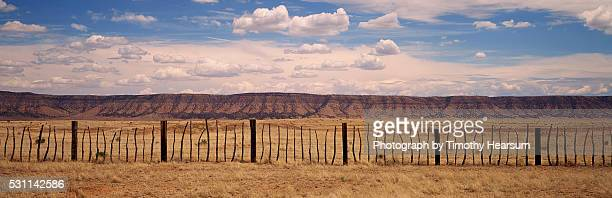 rustic fence in front of an arizona mountain range - timothy hearsum stock pictures, royalty-free photos & images