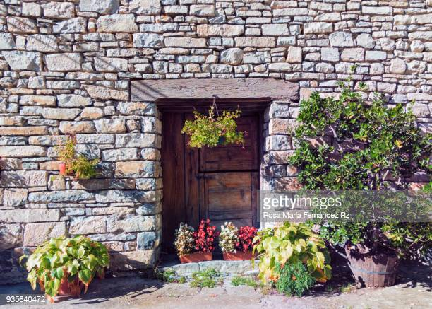 Rustic front door in Boltaña, typical village of Huesca, Pais Vasco, Northern of Spain, Europe