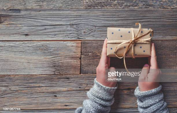rustic gift box on a wooden table. - giving stock photos and pictures