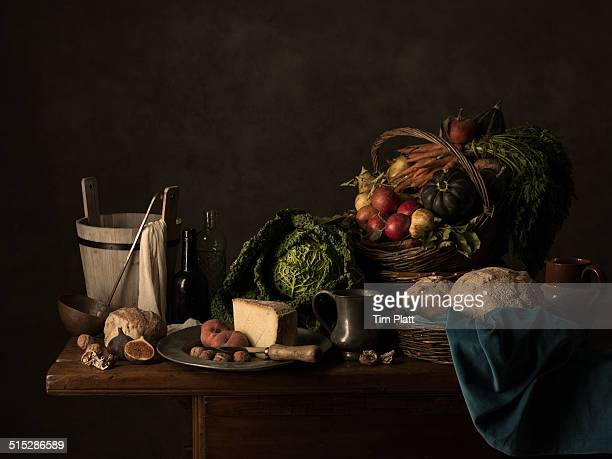 Rustic harvest foods on an old kitchen table.