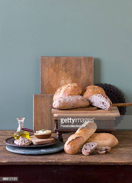 rustic loaves of bread on wooden table with spreads, close-up - cruet stock photos and pictures