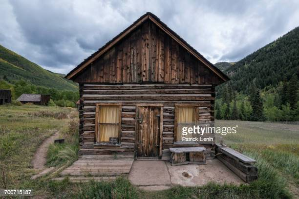 Rustic log cabin in valley