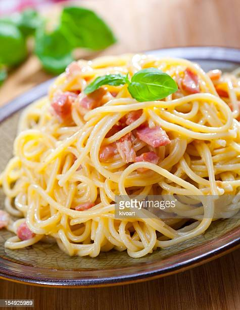 A rustic plate of spaghetti alla carbonara with bacon