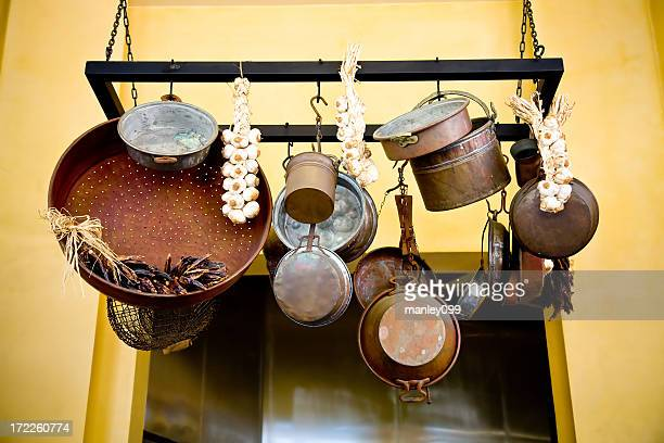 rustic pots and pans with garlic
