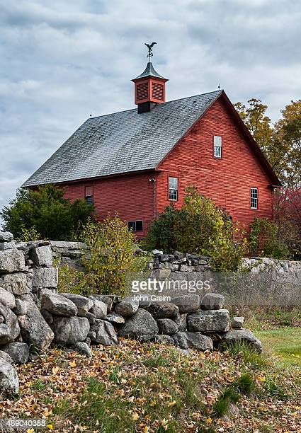 Rustic red barn and stone wall