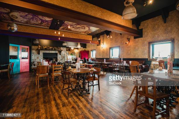rustic restaurant - wide shot stock pictures, royalty-free photos & images