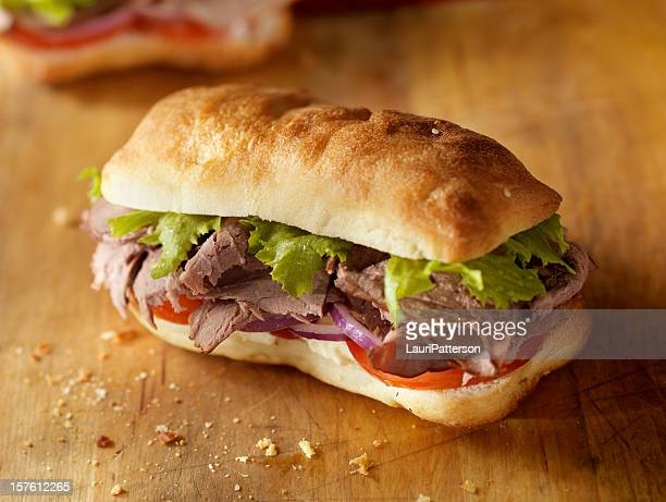 rustic roast beef sandwich - submarine sandwich stock pictures, royalty-free photos & images