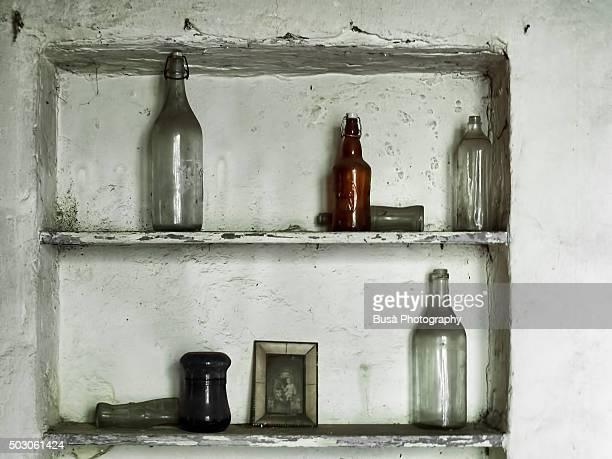 Rustic shelves with bottles and other objects