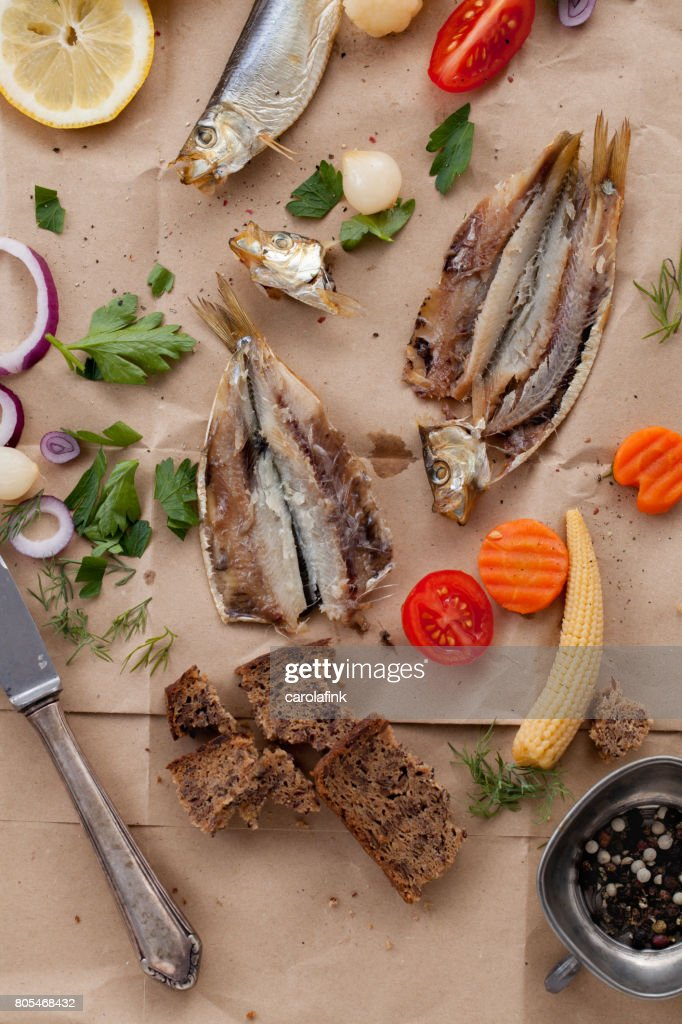 Rustic snack with fish and mixed pickles : Stock-Foto