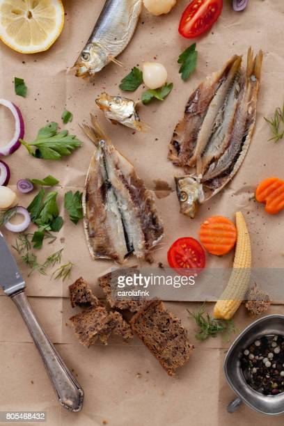 Rustic snack with fish and mixed pickles