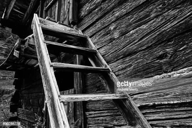 Rustic timber step ladder and wooden hut, barn, cabin in the Swiss Alps