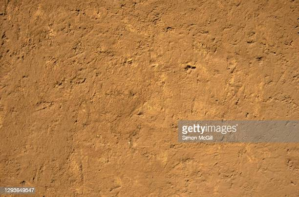 rustic weathered adobe wall - adobe stock pictures, royalty-free photos & images