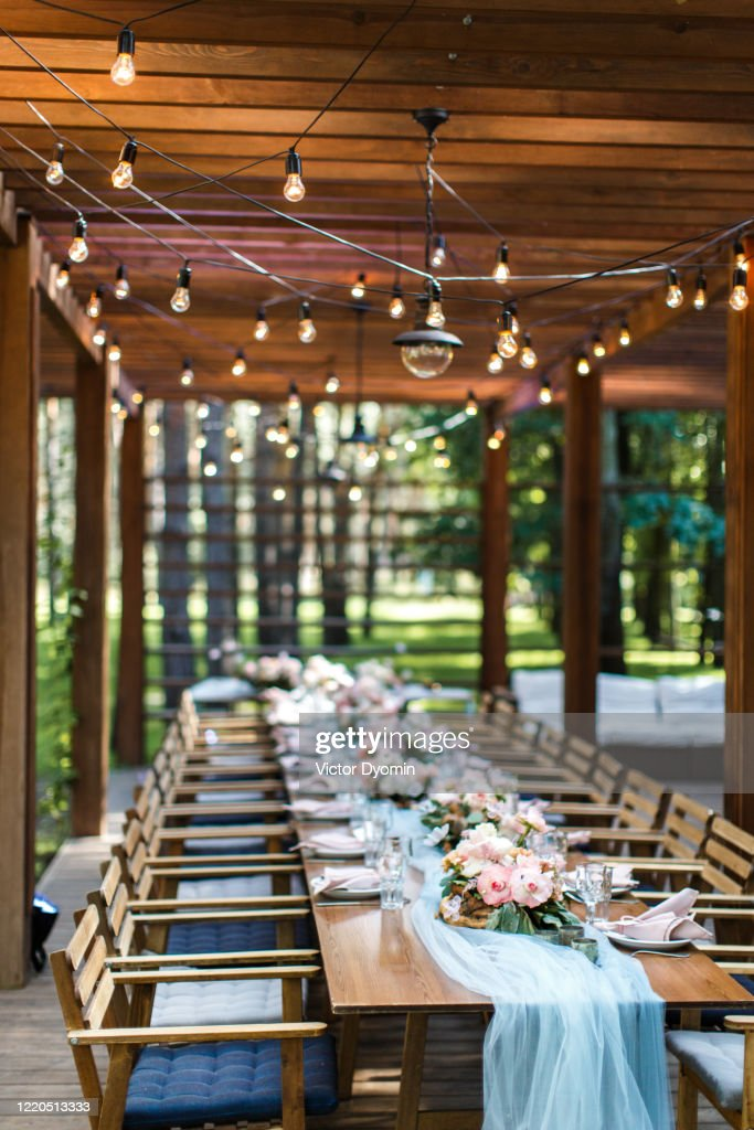A Rustic Wedding Table On The Terrace Of A Restaurant In The Forest High Res Stock Photo Getty Images