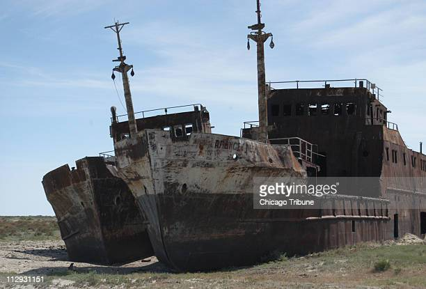 Rusting beached ships show where the Aral Sea once extended near the village of Zhalanash in Kazakhstan