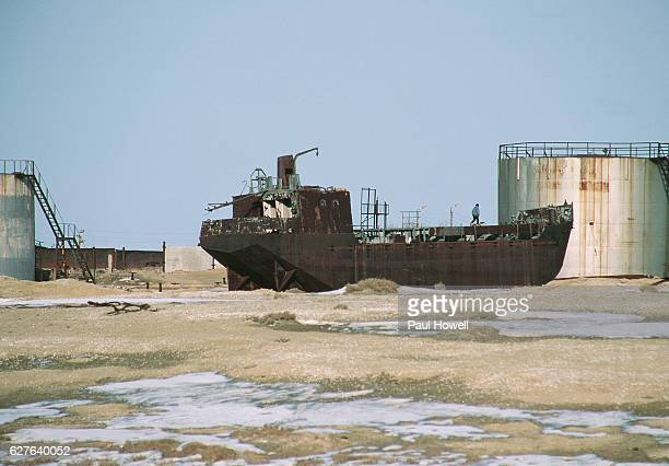 A rusting boat lies redundant in what was once the prosperous harbour of Aralsk Due to the diversion of the sea's 2 main tributary rivers the...