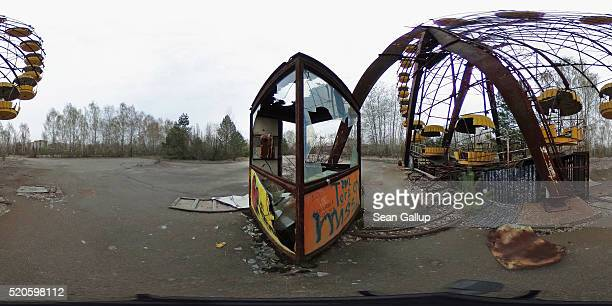 A rusting ferris wheel and ticket booth stand on April 9 2016 in Pripyat Ukraine Pripyat built in the 1970s as a model Soviet city to house the...