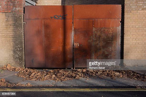 Rusting metal gates locked and secure on a street on 28th November 2016 near Camberwell south London borough of Southwark England