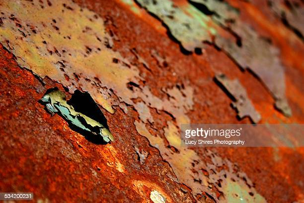 rusting metal with peeling paint. - lucy shires stock pictures, royalty-free photos & images
