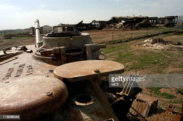 Rusting milary tanks left fom the IraqIran war are scattered across the countryside near QasreShirin Iran on February 15 2003 Residents saw relatives...