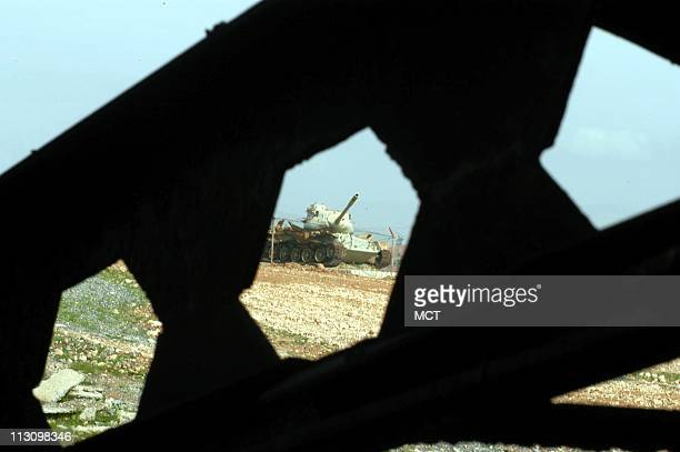 Rusting milary tanks left from the IraqIran war are scattered across the countryside near QasreShirin Iran on February 15 2003 Residents saw...
