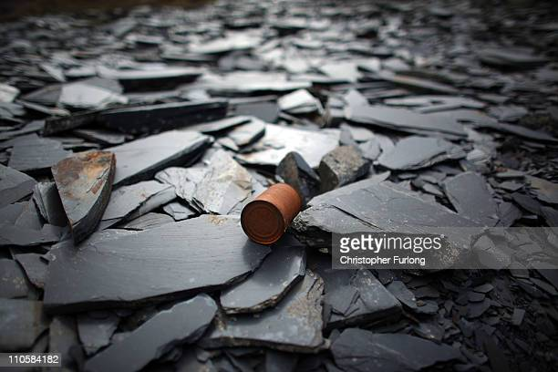 A rusting tin can sits on shards of slate at the Cwmorthin Quarry near Blaenau Ffestiniog which is on this year's list bidding for World Heritage...