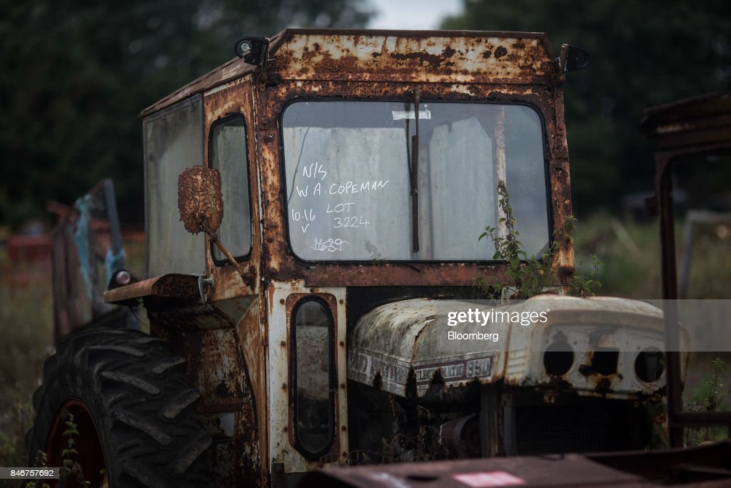 A rusting tractor, manufactured by David Brown Engineering Ltd., sits at the Cheffins Cambridge Machinery Sales monthly machinery and plant auction in Sutton, U.K., on Monday, Sept. 4, 2017. The debate over food andfarmingpolicy after Brexit has heated up recently, with Environment Secretary Michael Gove telling BBC Radio 4 that the U.K wouldnt lower its animal welfare or environmental standards to achieve any new trade deals. Photographer: Simon Dawson/Bloomberg via Getty Images