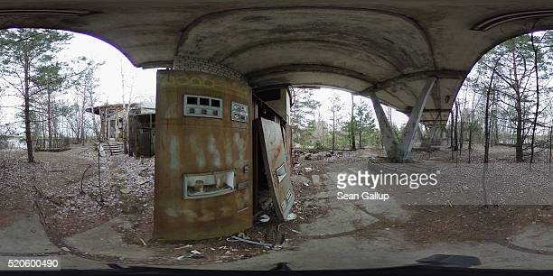 A rusting vending machine stands next to a former riverfront cafe on April 9 2016 in Pripyat Ukraine Pripyat built in the 1970s as a model Soviet...