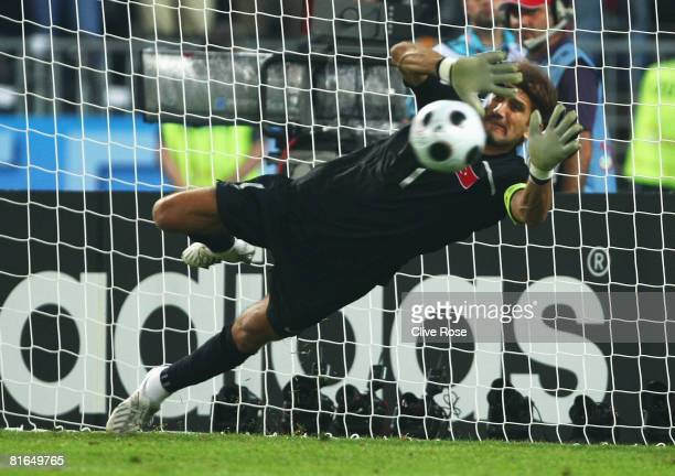 Rustu Recber of Turkey makes the save in the penalty shoot out to win the UEFA EURO 2008 Quarter Final match between Croatia and Turkey at Ernst...