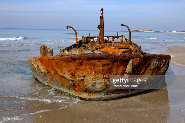 Rusty abandoned beached ship