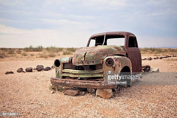 A rusty abandoned truck sits in the middle of the desert near Aus, Namibia.