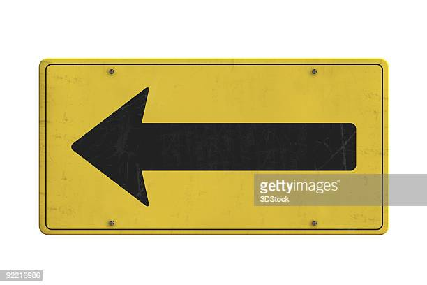 Rusty and weathered arrow sign plate