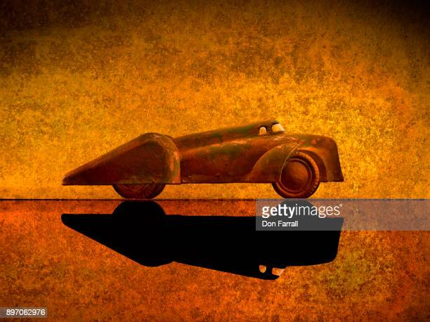 rusty antique toy car - don farrall stock pictures, royalty-free photos & images