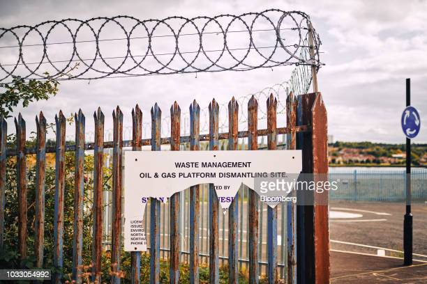 Rusty barbed-wire lined fence stands on the site of the former Swan Hunter shipyard in Wallsend, U.K., on Thursday, Sept. 6, 2018. The northeast of...